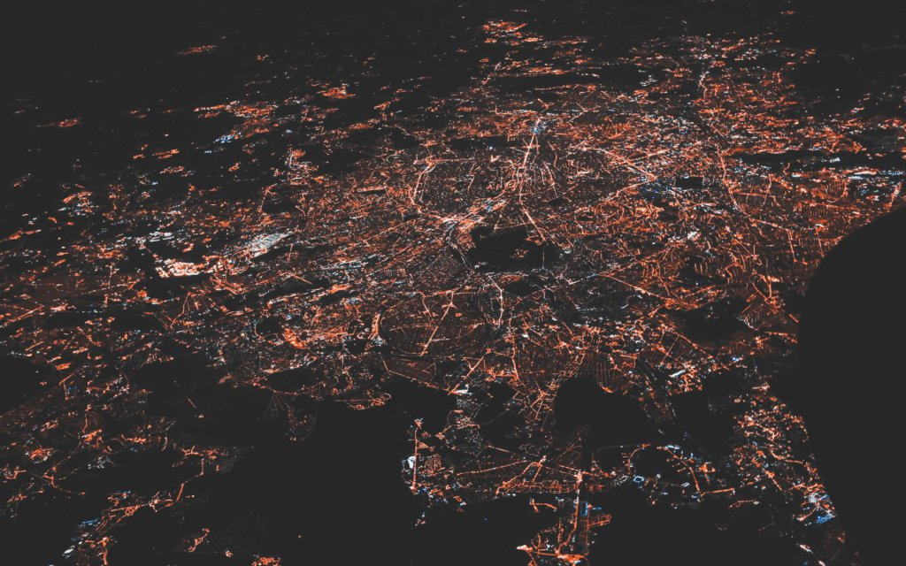 Image of a lit-up supplier network of a city from birds-eye view.
